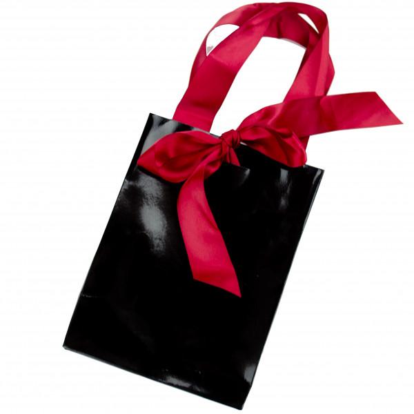 Schwarze Geschenktüte mit pinkem Satinband